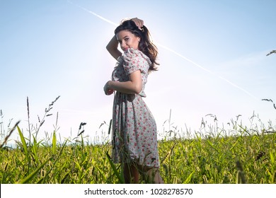 Beautiful young woman in the summer field
