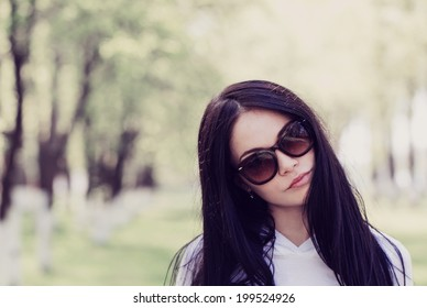 beautiful young woman in the summer park