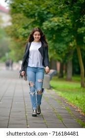 Beautiful young woman, summer park.