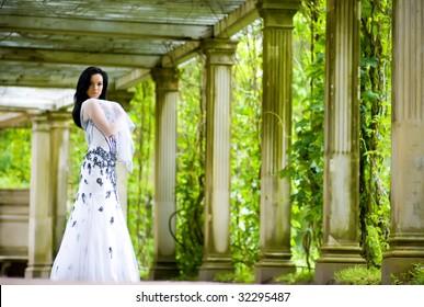 Beautiful young woman in summerhouse