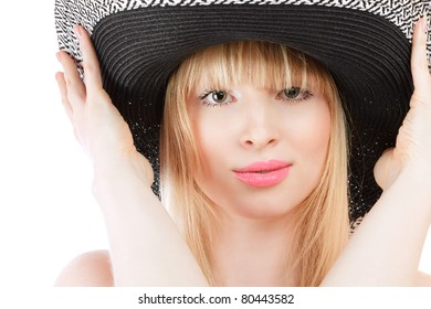 Beautiful young woman in sun hat studio shot isolated over white