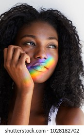 Beautiful young woman with sunlit rainbow pattern