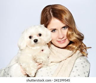 beautiful young woman and a sweet little white dog