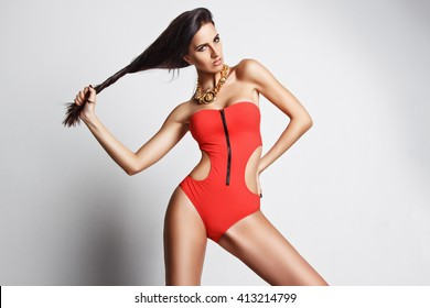 beautiful young woman in a swimsuit at the studio