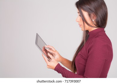 beautiful young woman with tablet in hands