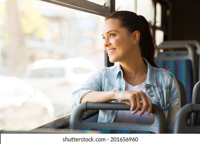 beautiful young woman taking bus to work