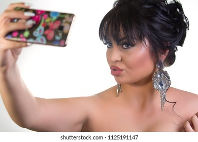 Beautiful young woman taking a self portrait