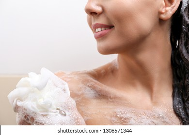 Beautiful young woman taking shower in bathroom