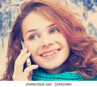 beautiful young woman talking on a mobile phone