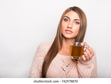beautiful young woman with teacup wearing a sweater
