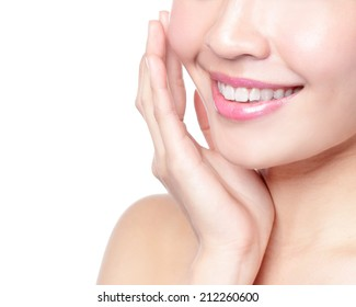 Beautiful young woman teeth close up. Isolated over green background, asian beauty model
