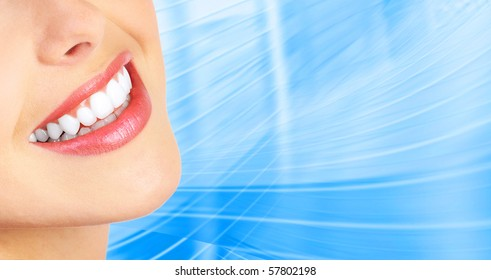 Beautiful young woman teeth. Over  blue background