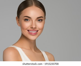 Beautiful young woman teeth smile healthy skin close up portrait