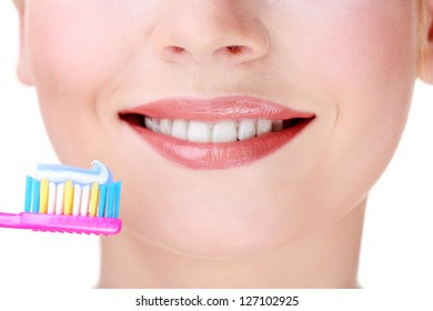 Beautiful young woman with toothbrush close-up