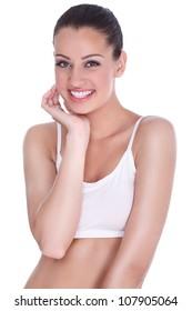 Beautiful young woman touching her face, fresh healthy skin
