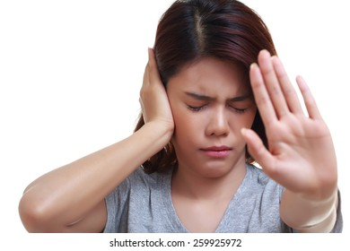 Beautiful young woman is touching her ear and closing her ears from noise and show showing stop gesture . Health concept.