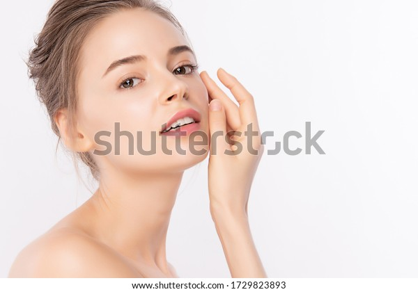Beautiful Young Woman touching her clean face with fresh Healthy Skin, isolated on white background, Beauty Cosmetics and Facial treatment Concept