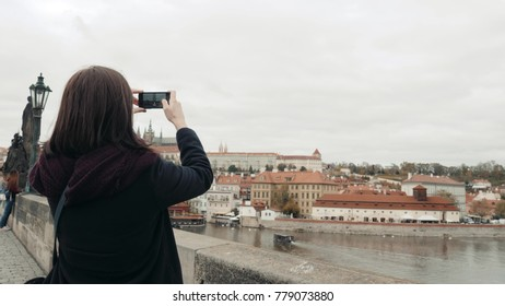 Beautiful Young Woman Tourist In Prague, Making Selfie or Taking Photo With Her Mobile Phone, Travelling Concept