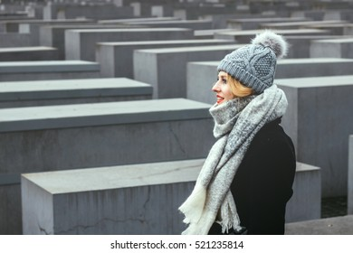 Beautiful Young Woman Tourist Walking at Holocaust Memorial to the Murdered Jews of Europe in Berlin, Germany - Holocaust-Mahnmal