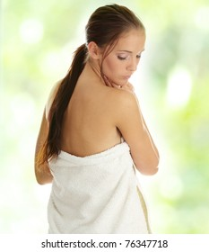 Beautiful young woman with towel, concept of spa, beauty, wellness salon,bath