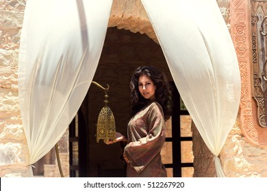 Beautiful young woman in a traditionally Moroccan caftan. Shooting took place in the old Medina.