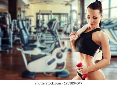 Beautiful young woman training at gym