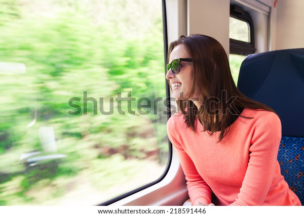Beautiful young woman traveling by train
