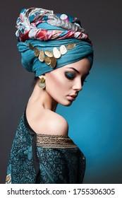beautiful young woman in turban and jewelry. asian beauty girl. fashion oriental style woman