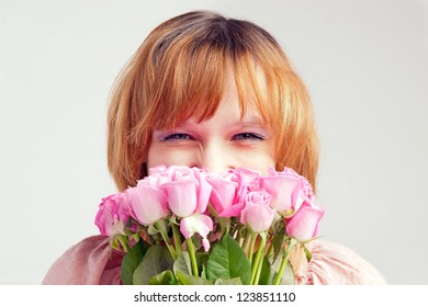 The beautiful young woman with union of roses