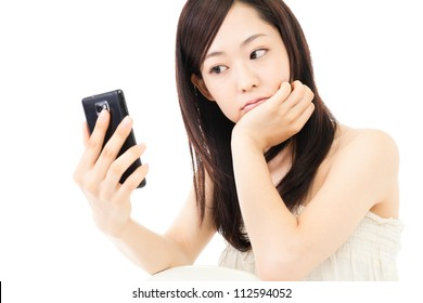Beautiful young woman using a cellular. Portrait of asian.