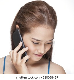 Beautiful young woman using her smart phone on white background.