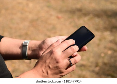 Beautiful young woman using a mobile