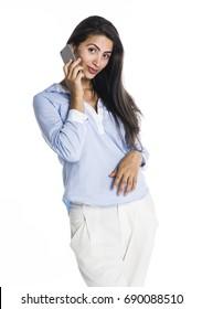 Beautiful young woman using phone