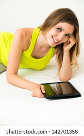 Beautiful young woman using tablet