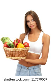beautiful young woman with vegetables in basket, isolated on white