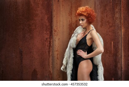 Beautiful young woman in vintage fashion fur