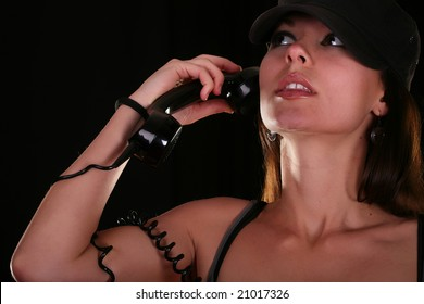 Beautiful young woman with vintage telephone closeup on black background