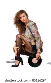 Beautiful young woman with vinyl disc in a hands