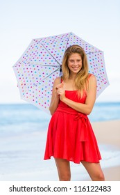 Beautiful Young Woman Walking on Tropical Beach with Colorful Umbrella