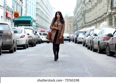 beautiful young woman walking on the street