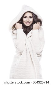 Beautiful young woman in warm sweater with a hood
