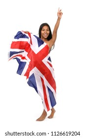 Beautiful young woman warped the flage of great britain smiling cheerfully