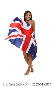 Beautiful young woman warped the flage of great britain smiling