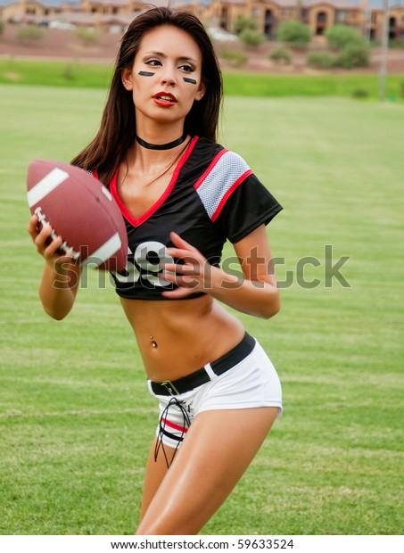 Beautiful Young Woman Wearing American Football Stock Image