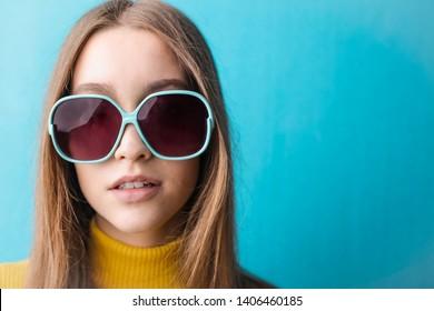 Beautiful young woman wearing big sunglasses.