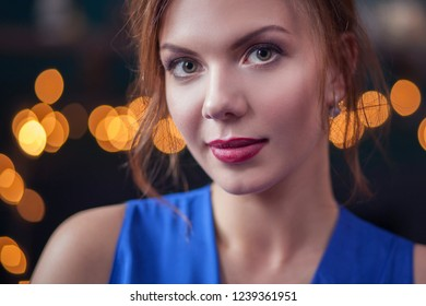 beautiful young woman wearing blue dress