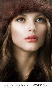 Beautiful Young Woman wearing Fur Hat.Winter Style