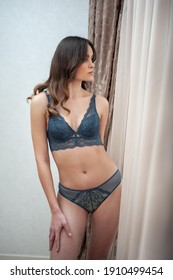 Beautiful young woman wearing lingerie at home