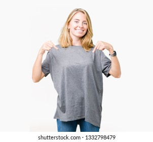 Beautiful young woman wearing oversize casual t-shirt over isolated background looking confident with smile on face, pointing oneself with fingers proud and happy.