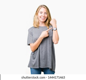 Beautiful young woman wearing oversize casual t-shirt over isolated background In hurry pointing to watch time, impatience, upset and angry for deadline delay